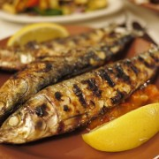 Whole Grilled Sardines, Resting On Fresh Tomato Sauce